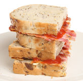 Bacon Sandwich. Thick bacon sandwich with wholewheat bread and tomato ketchup Royalty Free Stock Photography