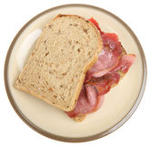 Bacon Sandwich. Crispy back bacon between granary bread slices. Shallow DoF, focus on bacon Royalty Free Stock Photos