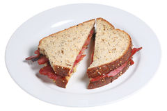 Bacon Sandwich. Crisp dry-cured streaky bacon between slices of multi-seeded batch bread Stock Photo