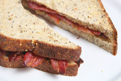 Bacon Sandwich. Close-up of bacon sandwich with fresh crusty bread Royalty Free Stock Photos