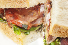 Bacon Sandwich. BLT style - British Bacon slices presented in a delicious sandwich stock image