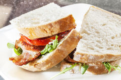 Bacon Sandwich. BLT style - British Bacon slices presented in a delicious sandwich royalty free stock photos