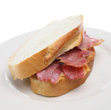 Bacon Sandwich. Grilled bacon in between slices of crusty white bloomer loaf bread Royalty Free Stock Photo