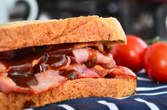 Bacon sandwich with brown sauce Stock Photos