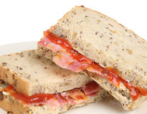 Bacon Sandwich with Tomato Ketchup. Crispy bacon in between slices of wholewheat granary bread Stock Photography