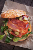 Bacon sandwich with tomato and pickles Royalty Free Stock Photos