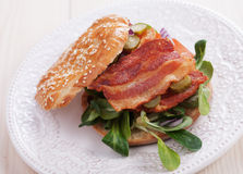 Bacon sandwich with tomato and pickles Royalty Free Stock Photo