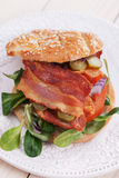 Bacon sandwich with tomato and pickles Royalty Free Stock Image