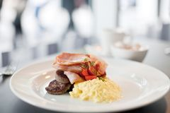 Bacon, sausage and eggs breakfast Stock Photo