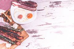 Tasty bacon, sausage and fried eggs Royalty Free Stock Photos
