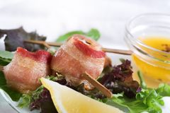 Bacon and scallop appetizers Royalty Free Stock Photography