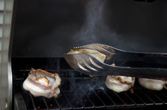 Bacon scallop on flame grill bbq Stock Photo
