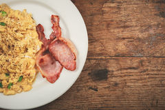 Bacon and scrambled eggs Stock Photos