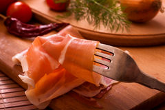 Bacon on silver fork Royalty Free Stock Photography