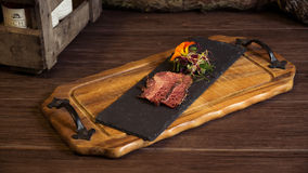 Bacon on a Slate. With Vegetables Royalty Free Stock Image