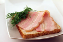 Bacon on a slice of bread Stock Images