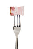 Bacon slice on fork Royalty Free Stock Photos