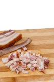 Bacon with sliced bacon cubes on the wooden board Royalty Free Stock Images