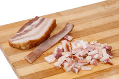 Bacon with sliced bacon cubes on the wooden board Royalty Free Stock Photo