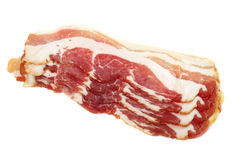 Bacon. Sliced Pork Bacon on white background Royalty Free Stock Photo