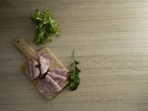 bacon sliced on a wooden background stock image