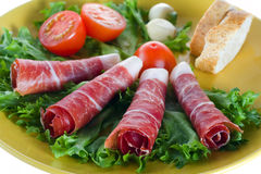 Bacon snack. With vegetables on a plate Stock Photos