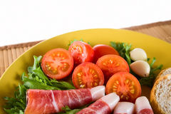 Bacon snack. With vegetables on a plate Royalty Free Stock Image