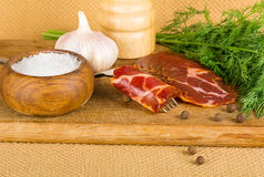 Bacon and spices Stock Images