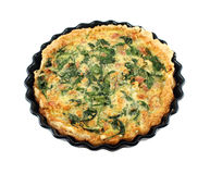 Bacon And Spinach Quiche. Fresh baked homestyle spinach and bacon quiche straight from the oven Royalty Free Stock Photo