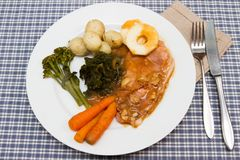 Bacon steaks with cooked vegetables Stock Photo
