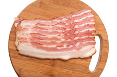 Bacon strips arranged on a kitchen board Royalty Free Stock Image