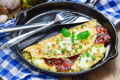 Bacon stuffed omelette with backed beans Stock Image