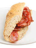 Bacon Sub Roll. Streaky bacon in a granary baguette with tomato ketchup Stock Photography