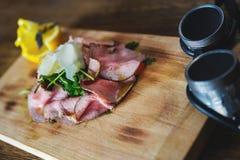 Bacon sulla tavola di legno Immagine Stock
