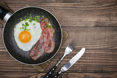 Bacon with sunny side up egg Royalty Free Stock Images