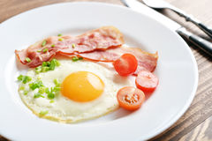 Bacon with sunny side up egg Stock Images