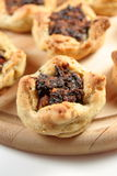 Bacon tarts. Mini flower shaped tarts made of wholewheat flour and bacon filling stock images