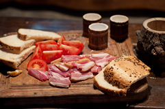 Bacon, tomato, bread and moonshine Royalty Free Stock Photo