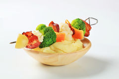 Bacon and vegetable skewer and potato puree Stock Images