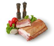 Bacon and vegetables. Two pieces of bacon and some vegetables Royalty Free Stock Photos