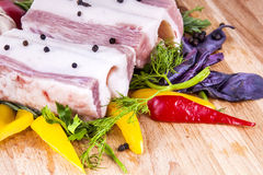 Bacon with vegetables and herbs. Lard bacon with vegetables and herbs Stock Image