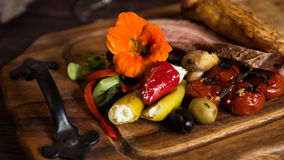 Bacon with Vegetables. On a Wooden Board Stock Image