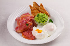 Bacon on white plate. Grilled rashers. Royalty Free Stock Images