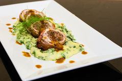 Bacon wrap pork stuff with seafood spinach mashed potato Stock Photo