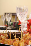 Bacon wrapped appetizers and crystal on table Stock Images