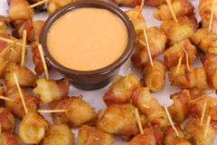 Bacon wrapped appetizers and dip Royalty Free Stock Photo