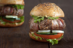 Bacon wrapped burger Royalty Free Stock Images