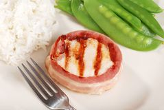 Bacon wrapped chicken with fork Stock Photography