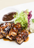 Bacon wrapped chicken leg. Western food - bacon wrapped around chicken leg Stock Images