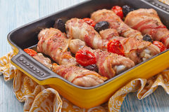 Bacon wrapped chicken legs Stock Image